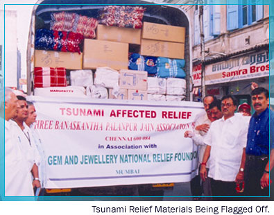 Tsunami relief materials being flagged off.